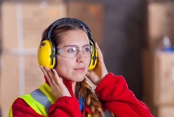 lady with reflective vest and yellow ear protection